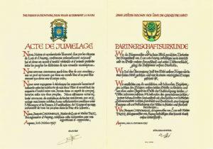 """Beispiel einer Partnerschaftsurkunde zwischen Lure/Frankreich und Asperg /Deutschland aus dem Jahr 1967 (""""Jumelage"""" ist der französische Begriff für Städtepartnerschaft und ist dem Wort """"Zusammenfügen"""" entlehnt). Quelle: Stadt Aspeg"""